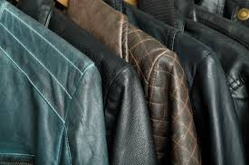 a row of leather jackets hanging up