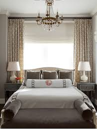 in the master bedroom custom bedding from leontine linens in new orleans in white piqué with a charcoal linen appliqué sets a refined tone