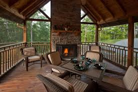 spacious screened in porch with wood burning fireplace