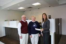 Al and Tippi Bevan with Tara Fordham _ BNB Branch Manager - Shelter Island  Reporter