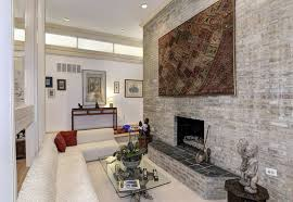small sunken living room with stone fireplace
