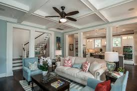 tributary traditional living room idea in charleston with blue walls ceiling fans baseboards ceiling fan
