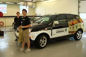 lot porters and interns helping detail the honest tea van before an event porter dealership