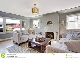 Light Grey Living Room Light Grey Living Room With White Sofas And Fireplace Stock Photo
