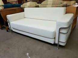 two seater pull out sofa and white leather 2 seater sofa which pulls out as a