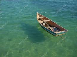 Small row boat floating on the water  Stock Photo #10191813