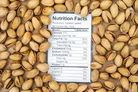 nutrition facts of roasted salted pistachios with nuts background stock photo 81016059