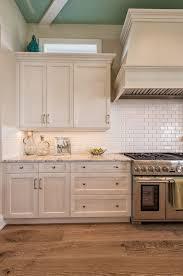 Beautiful wire brushed oak floors! Off-white cabinets, white subway tile,  grey