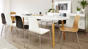 luxury round extendable dining room tables 34 extending table long oval shaped of white finished wooden with legs brown and black nine chair