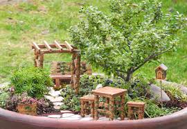 gazebo and bench table and two stools bucket and bird house all made fairy gardens remembering