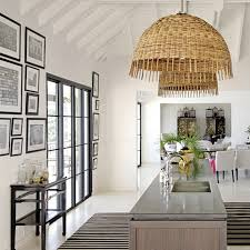 rattan pendant lighting. white open plan kitchen and dining area island unit dark wood fitted units basket style rattan ceiling pendant lights shades eaves timber frame real lighting