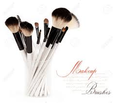 makeup brushes photography. makeup brush set in a glass beaker isolated on white background stock photo - 12835630 brushes photography