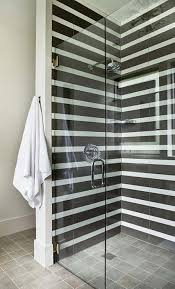 shower with black and white stripe tiles view full size