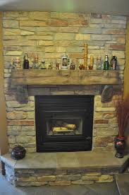 Railroad Tie Mantle stones fireplace with barn beam mantle and natural stone j&n stone 8818 by xevi.us