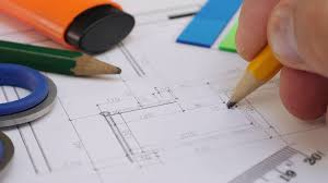 Young Architect House Designer A Young Architect Or Designer Is Working On A Project Of A House Or Apartment Drawing Pencil On Paper Pencil Ruler Marker And Other Stationery On The Table