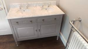 victorian washstand with undermount sinks and granite top