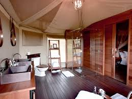 one nature nyaruswiga serengeti luxury family tent en suite bathroom with glass enclosed shower