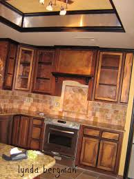 painting black an antique copper special finish on kitchen cabinets