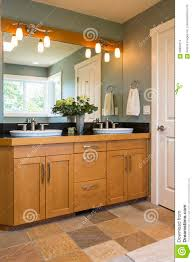 cabinet accent lighting. Bathroom Vanity With Wood Cabinets, Double Sinks, Slate Tile Floors And Accent Lighting In Contemporary Upscale Home Interior Cabinet T