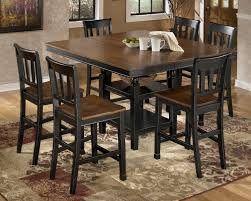 extendable dining room table by signature design by ashley. room · owingsville 7-piece counter extension table set by signature design ashley extendable dining