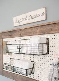 a framed pegboard with metal crate shelves over the changing table is a great idea