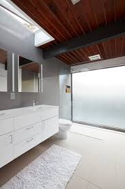 the home s bathrooms feature lacava undermount sinks hansgrohe fixtures and duravit toilets natural