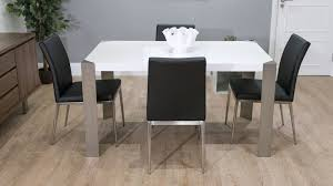 stylish black dining chairs and white gloss dining table