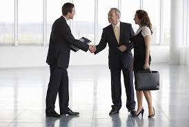 real estate agency law fiduciary duties business man shaking hands real estate agent in commercial space