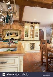 Brick Kitchen Floors Terracotta Floor Tiles And Exposed Brick Wall In Country Kitchen