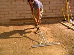 use a rake to level patio area before laying pavers