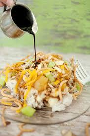 hawaiian haystacks recipe has a rice base white sauce cheese pineapples coconut