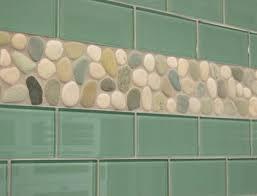 sage green glass subway tile backsplash