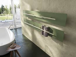 the teso towel rail warmer is sleek as sleek can be how clever to roll the towels and place them vertically and it s a very thin design available in 200
