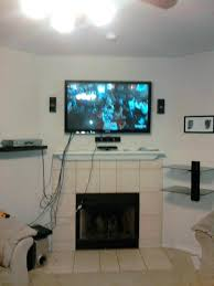 how to hide cords on wall mounted tv above fireplace hide those annoying speaker how to