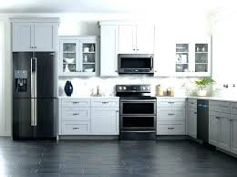 how to decorate a kitchen with black appliances black and grey kitchen white cabinets black appliances