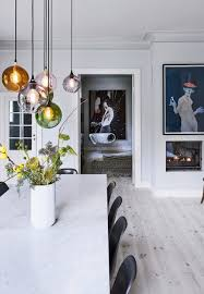 over the table lighting. beautiful pendants over the dining table in different colors lighting