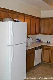 white fridge in kitchen. the space was dark, cramped, cave like and let\u0027s not leave out, orange. home is all second story living overall square footage only 1300 white fridge in kitchen