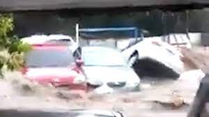 Cars Washed Away in El Salvador During ...