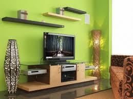 sage green living room floor lamp green wall color comfy green cushion varnished wood side table black curved modern sofa