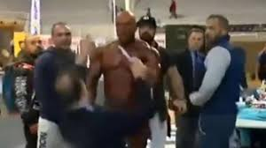 raging bodybuilder pulls out then slaps judge after losing