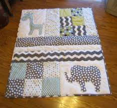 What pure fun making this quilt was! You forget how fast baby ... & Handmade Baby Quilt with elephant and giraffe applique. $120.00, via Etsy. Cot  QuiltBaby Patchwork ... Adamdwight.com