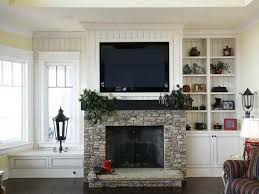 fireplace mantels with tv above popular on mantel moraethnic regard to over ideas designs in 12