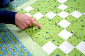 How to Tie a Quilt Tutorial - Quilting Tutorial from ... & With the opposite hand on the back of the quilt, feel for the needle (don't  poke yourself!) and guide it through the layers and back up through all the  ... Adamdwight.com