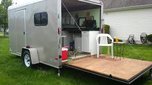 diy camping utility trailer woman converts cargo trailer into stealthy and cozy off grid rv