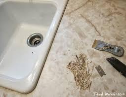 fixing a damaged sink remove caulk
