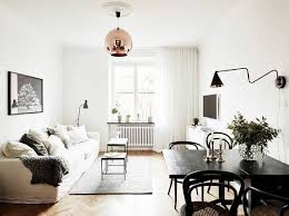 living room and dining room design. combination living and dining space with tom dixon copper pendant room design