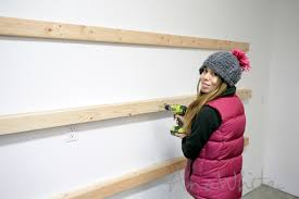 simply 2x4s to studs in your wall wherever you want a shelf you can put a shelf at any height you can custom fit over bicycles or strollers