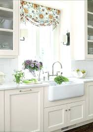 linen kitchen cabinets linen white cottage kitchen features glass front upper cabinets and cream base cabinets linen kitchen cabinets