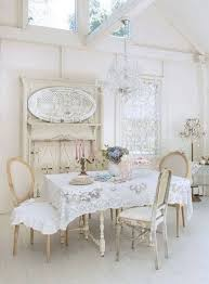 elegant shabby chic dining room with lace table cloth and vine crystal chandelier