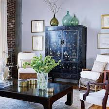 antique chinese cabinet and asian inspired coffee table mixed with things like rattan chairs asian inspired coffee table